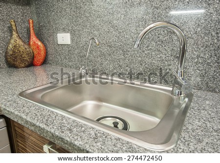 Interior design decor of kitchen in luxury apartment with sink and faucet - stock photo