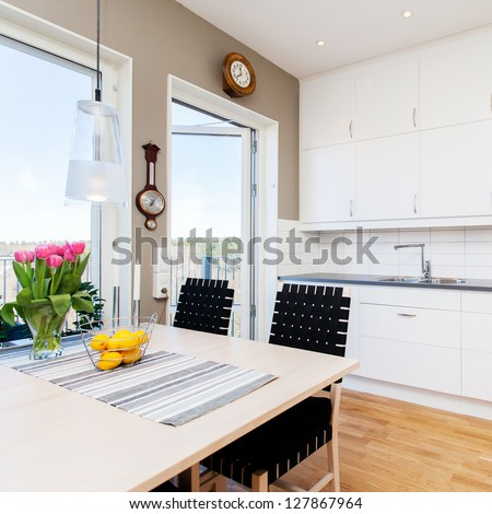 interior design, kitchen with kitchen table by the window - stock photo