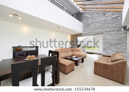 Interior design: Modern dining room and Living room with big empty white wall - stock photo
