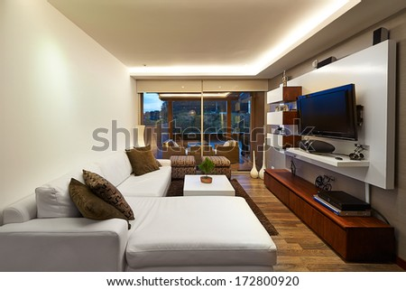 Interior design: Modern living room with big empty white wall