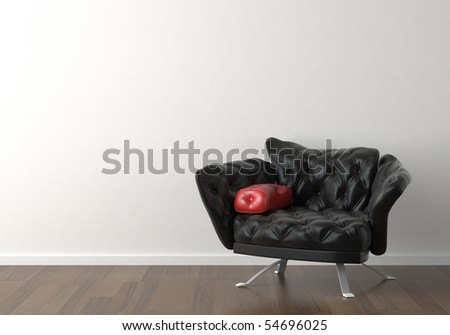 Interior design of a black leather armchair against a white wall with copy space on the top left corner - stock photo