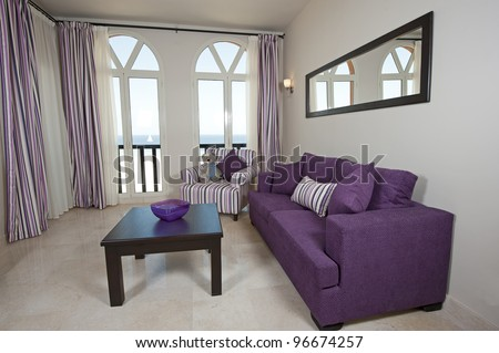 Interior design of a luxury apartment living room with a sea view - stock photo