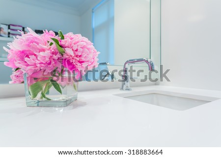 Interior design of a luxury bathroom and flower decoration - stock photo