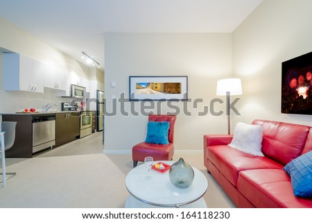 Interior design of a luxury living room and a small kitchen - stock photo