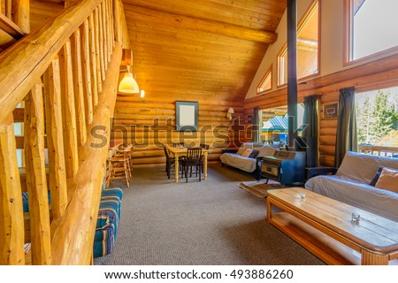 Interior design of a luxury living room in a small log cabin or cottage.