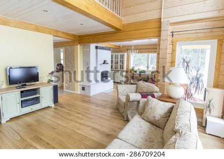 Interior design of a modern wooden log house living room - stock photo