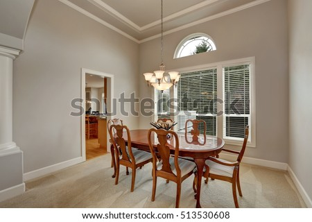 Interior design of American dining table in classic style. Wooden table set with elegant chandelier. Northwest, USA