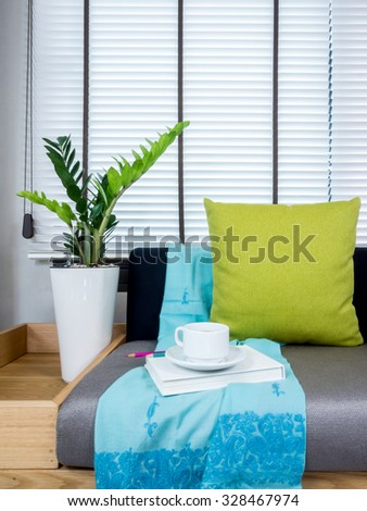 Interior design of couch with flower vase in modern Living room/ home improvement concept - stock photo