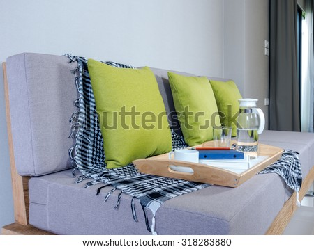 Interior design of light meal tray on couch in modern Living room/ home improvement concept - stock photo