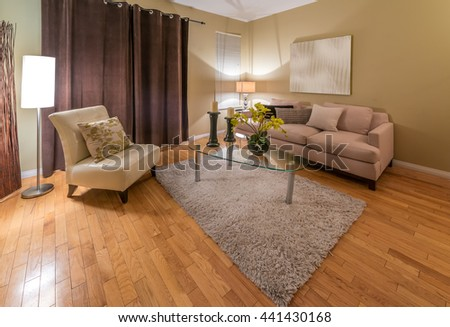 Interior design of luxury nicely decorated modern living room, suite with sofa, coffee table and chairs. Interior design. - stock photo