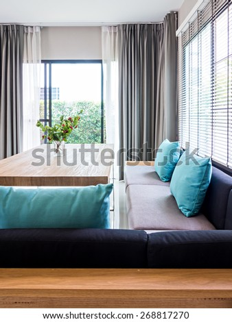 Interior design of minimalist modern dining room with sofa - stock photo