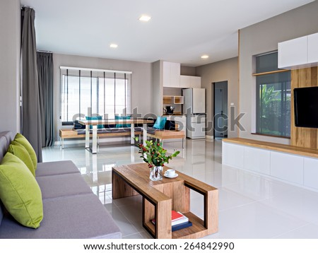 Interior design of minimalist modern Living and Dining room with sofa - stock photo