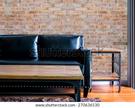 Interior design of  modern Living room with black leather couch /brick wall background - stock photo