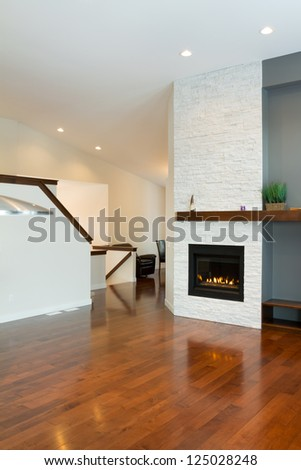 Interior design of modern Living room with fireplace in a new house - stock photo