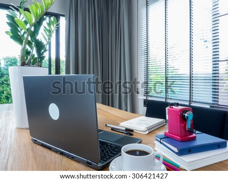 Interior design of modern working table with laptop computer at home office