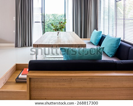 Interior design of neutral modern dining room with garden view - stock photo