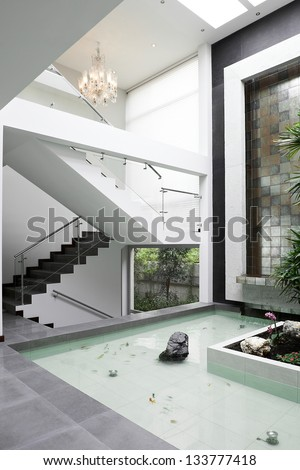 Interior Design: Stairs and Waterfall - stock photo