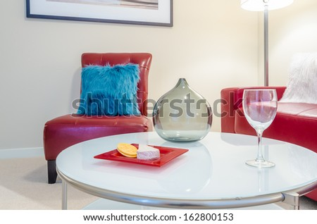 Interior Design With Couch, Colorful Cushions, Glass And Cheese With  Crackers On End Table