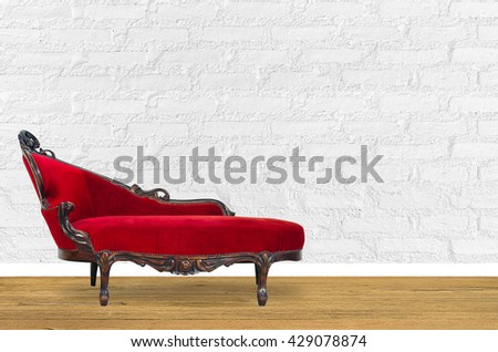 Interior design with red chair in fornt of white wall.