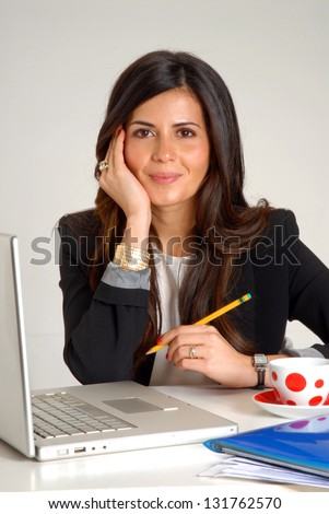 Interior designer and architect latin woman working on computer. - stock photo