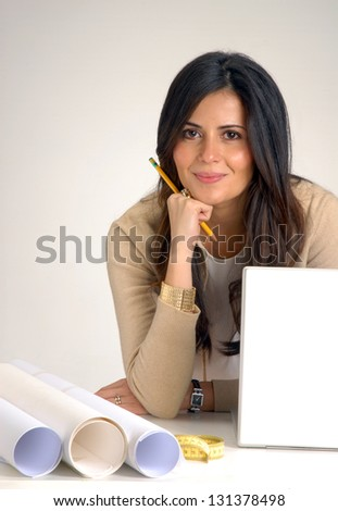 Interior designer and architect woman working on computer. - stock photo