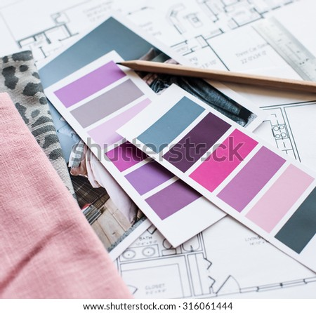 Interior designer's working table, an architectural plan of the house, a color palette, furniture and fabric samples in grey and pink color. Drawings and plans for house decoration. - stock photo