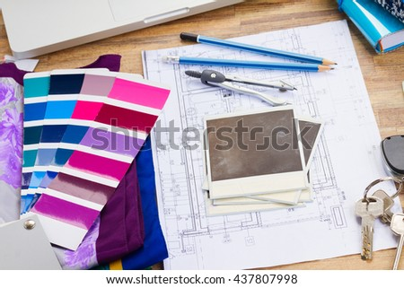 Interior designer's working table, an architectural plan of the house, color palette guide and fabric samples in lilac shades, copy space on instant empty photos - stock photo