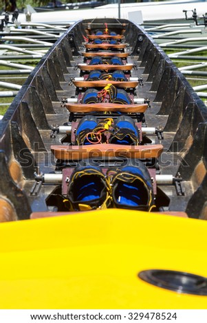 interior detail of a rowing boat scull for 8 rowers showing abstract pattern of positions inside - stock photo