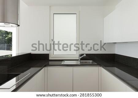 Interior, empty domestic kitchen of a modern apartment - stock photo