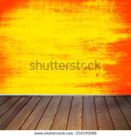 interior grunge background, garish red and yellow painted old grunge wall texture and brown wood floor - stock photo