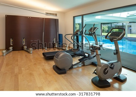Interior, gym of a modern house with spa - stock photo