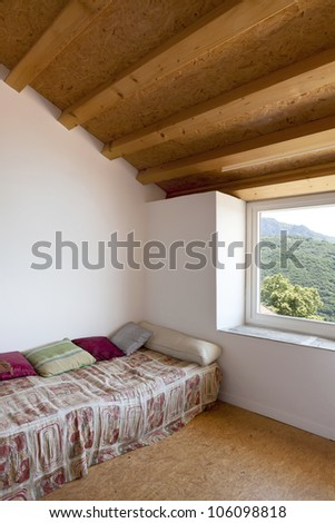 interior home, room with small bed - stock photo