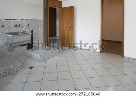 Interior house, empty laundry, gray tiled floor  - stock photo