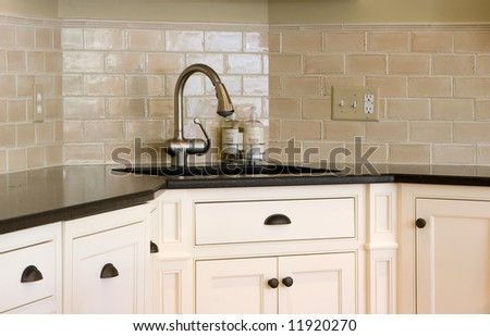 interior kitchen showing a close up of a corner sink