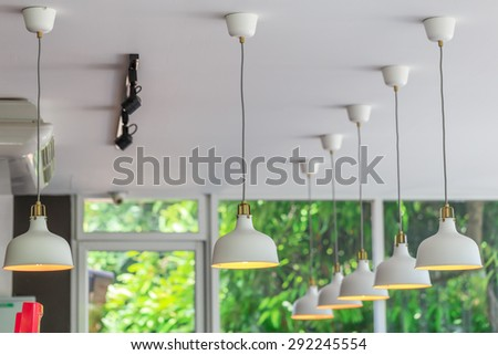 interior lamp in line on the ceiling of cafe  - stock photo