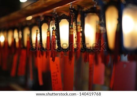 Interior lanterns of Man Mo Temple in Hong Kong, China. - stock photo