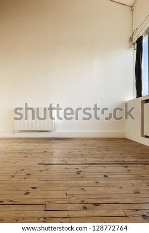 interior loft, beams and wooden floor - stock photo