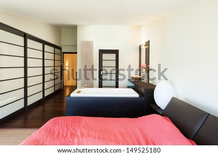 interior luxury apartment, beautiful bedroom with jacuzzi - stock photo