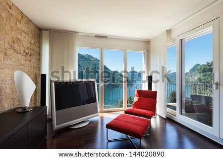 interior luxury apartment, comfortable red armchair - stock photo