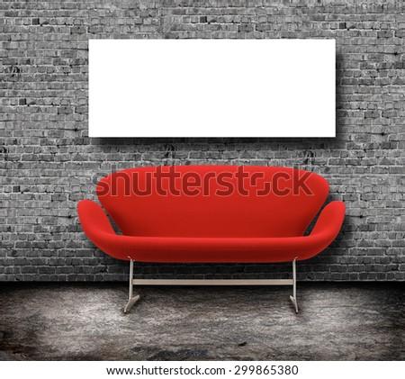 Interior Mock Up poster, big red retro sofa, grey brick wall background - stock photo