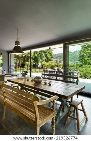 Interior, modern house, dining room. rustic furniture - stock photo