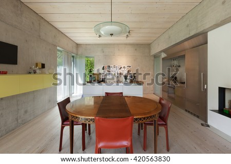 Interior, modern kitchen with wooden dining table, concrete walls