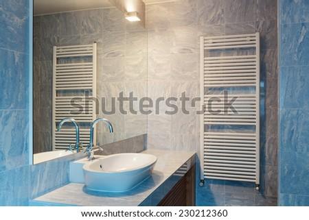 Interior modern loft, blue bathroom - stock photo