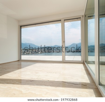 Interior, modern penthouse, empty living room with large windows - stock photo