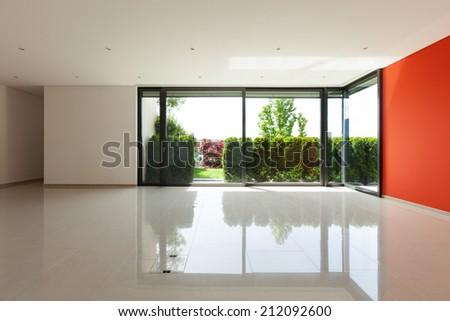 Interior modern villa, wide living room with windows - stock photo