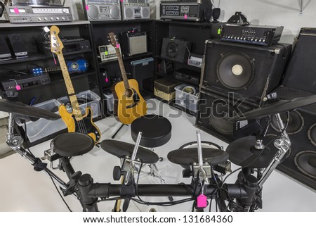 Interior music store with vintage used equipment. - stock photo