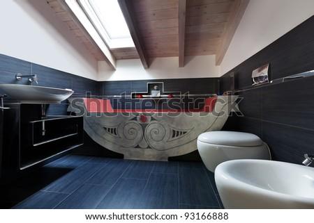 interior, new loft furnished, bathroom with bath - stock photo
