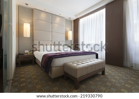 Interior of a bedroom in luxury apartment - stock photo