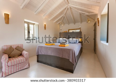 interior of a bedroom with beautiful decoration in a summer resort in Greece
