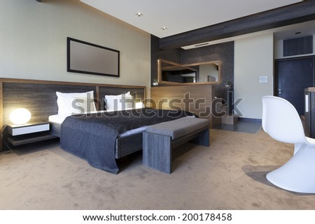 Interior of a bedroom with jacuzzi bath near the bed - stock photo